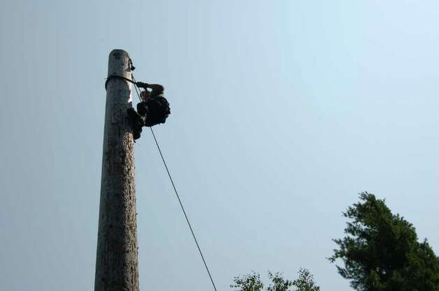 A student practices speed-climbing a pole at the Adirondack Woodsmen's School at Paul Smith's College on Tuesday July 19, 2011. (Scott Waldman / Times Union) Photo: Scott Waldman