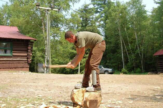 A student hones his ax skills at the Adirondack Woodsmen's School at Paul Smith's College on Tuesday July 19, 2011. (Scott Waldman / Times Union) Photo: Scott Waldman