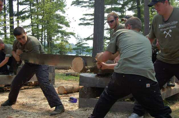 Students compete against one another in a sawing competition on Tuesday July 19, 2011. The timber sports practice was held at the Adirondack Woodsmen's School at Paul Smith's College.  (Scott Waldman / Times Union) Photo: Scott Waldman