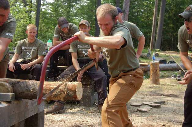 Robert Meehan, of Chatham, competes in a sawing competition against his fellow students at the Adirondack Woodsmen's School at Paul Smith's College on Tuesday July 19, 2011. (Scott Waldman / Times Union) Photo: Scott Waldman