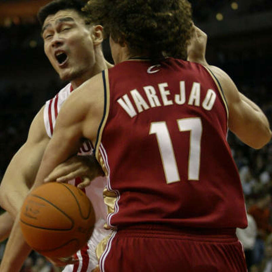 When Tracy McGrady left the game, Yao Ming, left, took on extra responsibilities. Photo: Jessica Kourkounis, For The Chronicle