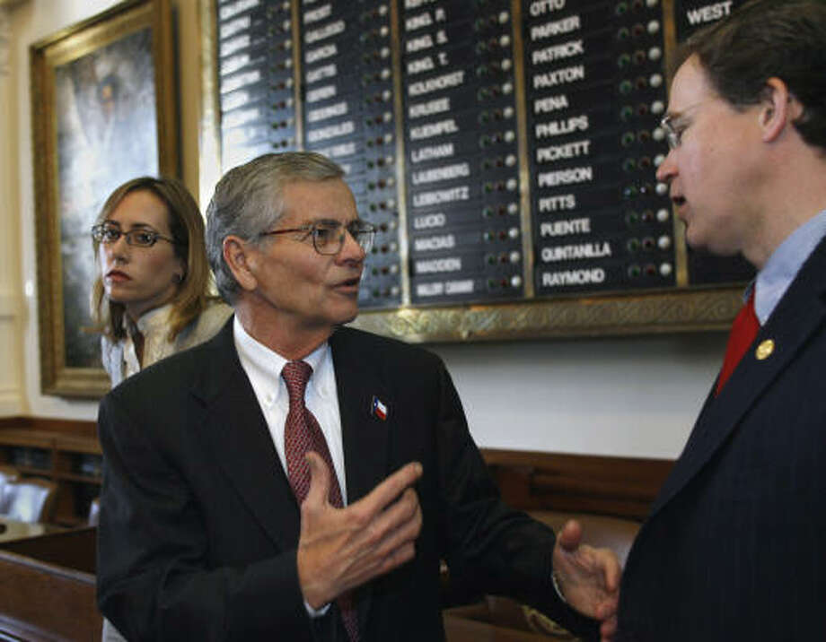 Texas House Speaker Tom Craddick, R-Midland, talks with Rep. Dan Branch, right, R-Dallas, at the Capitol in Austin. A House Democrat says Rep. Jim Pitts' keeping his list of supporters quiet makes sense because Craddick's camp would unleash an avalanche of calls and e-mail on them. Photo: Harry Cabluck, AP