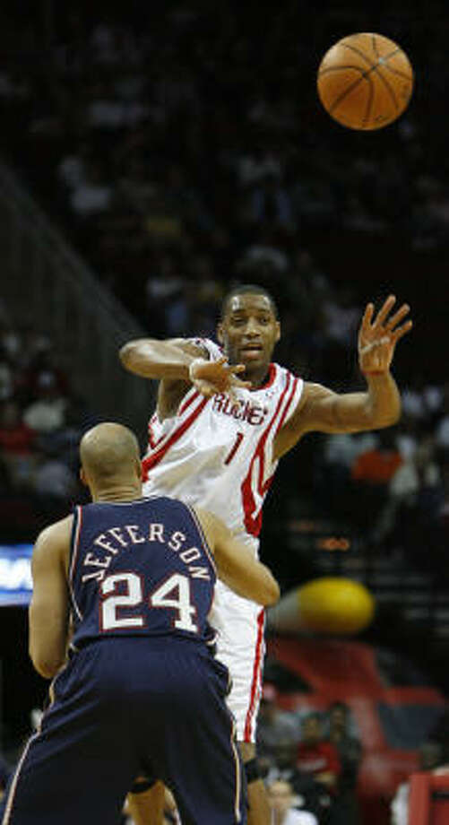 Tracy McGrady's 34 points helped the Rockets get a win over Richard Jefferson and the New Jersey Nets. Photo: KAREN WARREN, Chronicle