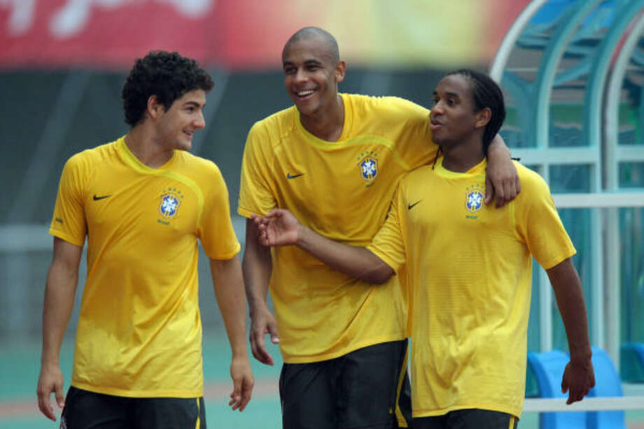 Brazil's Pato, Alex Silva work out for the Olympics at Shenyang, China. They face Belgium on Sunday. Photo: STR, AFP/Getty Images