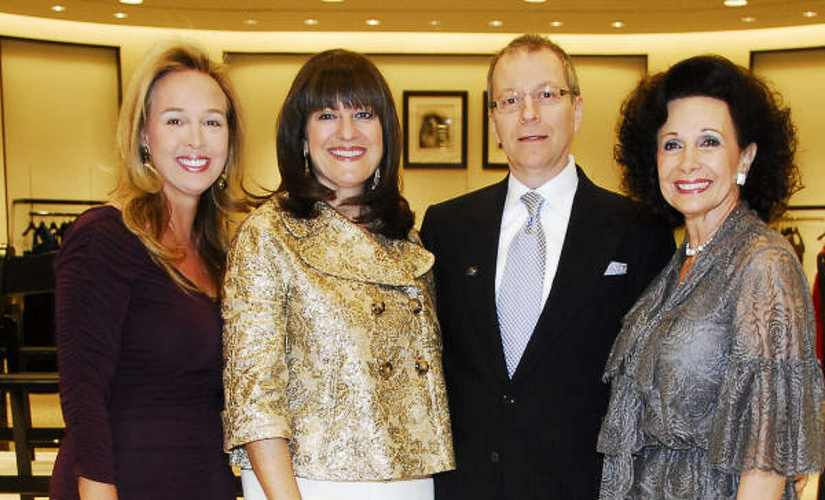 Winter Ball chairs Julie Brown, from left, Ellie Francisco and Philamena Baird flank Saks Fifth Avenue general manager Terry Zmyslo in the store's designer salon, where they welcomed guests to the Women of Distinction announcement party.
