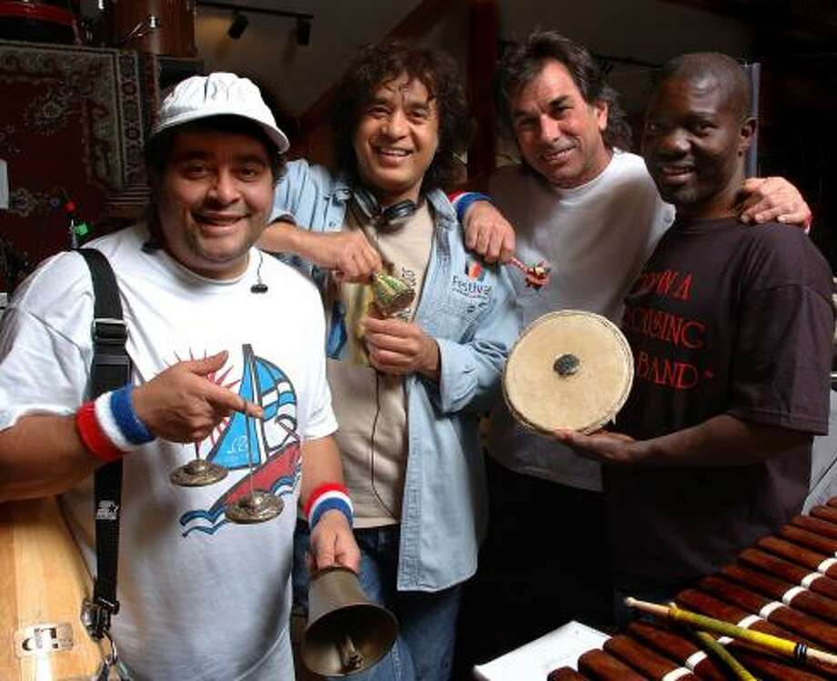 Mickey Hart, second from right, and his Global Drum Project play Sunday at Wortham Theater Center. Photo: JOHN WERNER