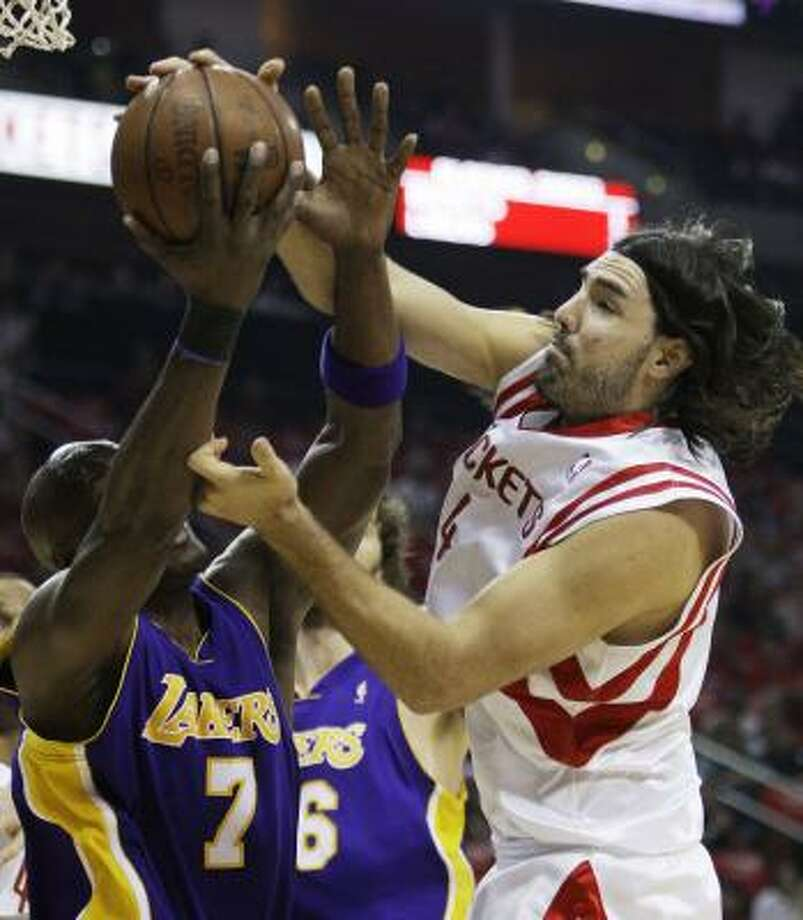 Luis Scola battles Lakers  forward Lamar Odom for a rebound in the first quarter. Photo: Eric Gay, AP
