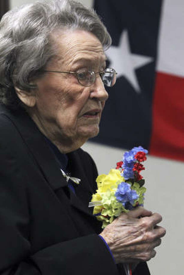 Ella Wheeler-McLeod, sister of highway patrolman Edward Bryan Wheeler, accepts the Yellow Rose of Texas award. Photo: Tom Reel, San Antonio Express-News