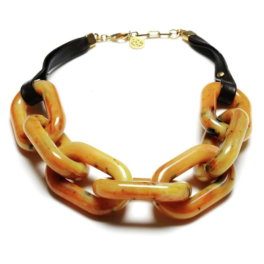 This product image courtesy of Ben-Amun shows the Ben-Amun Camel Resin Link Necklace with leather strap. The links are made with Italian resin, a form of Lucite.   Lucite is an enduring symbol of mid-century modern style spanning home furnishings and decor, industrial design and retail merchandising, contemporary art and costume jewelry. (AP Photo/Ben-Amun) Photo: AP