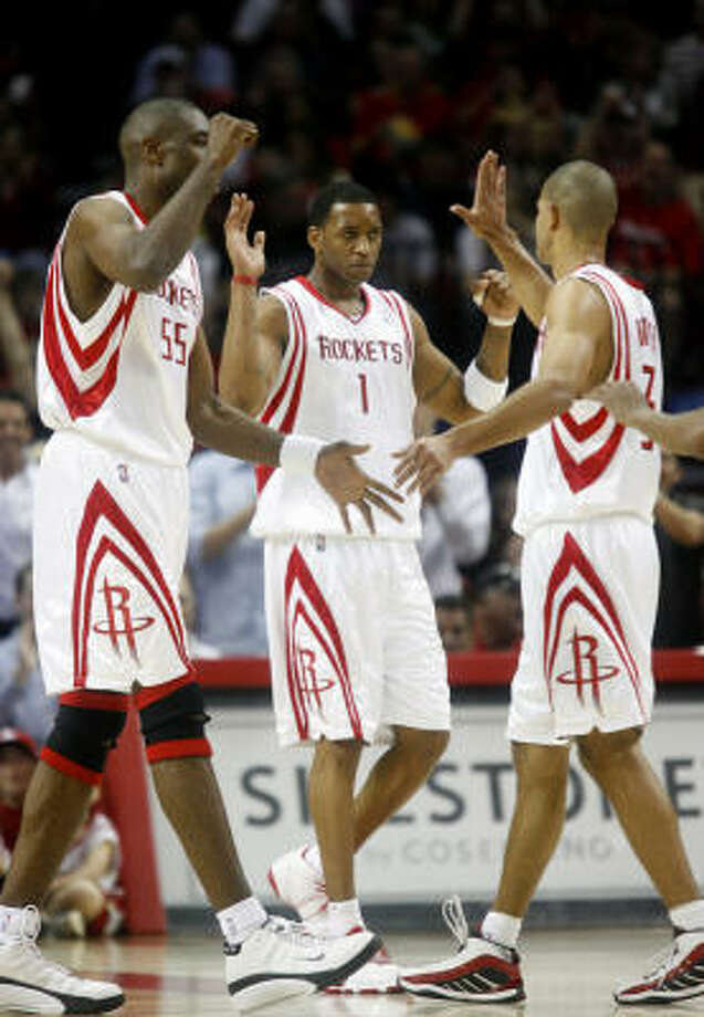 The Rockets celebrate a first-half basket. Photo: Karen Warren, Chronicle