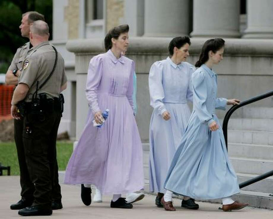 Members of the Fundamentalist Church of Jesus Christ of Latter Day Saints arrive at the Tom Green County Courthouse in San Angelo today. Photo: Eric Gay, AP