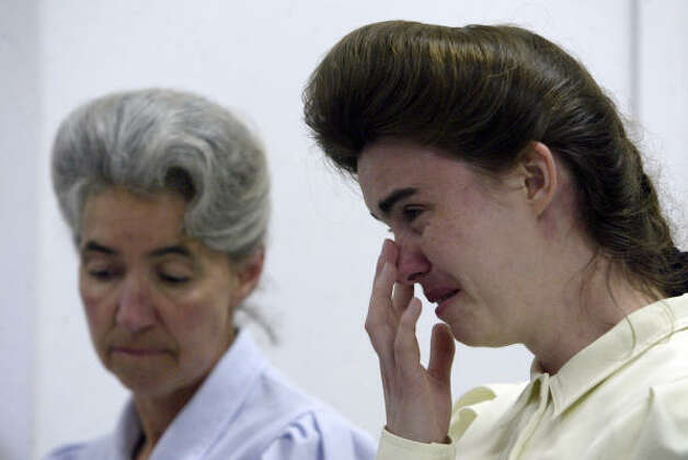 Lori, right, and Madeline, both members of the Fundamentalist Church of Jesus Christ of Latter Day Saints talk with media. Photo: Cynthia Esparza, AP