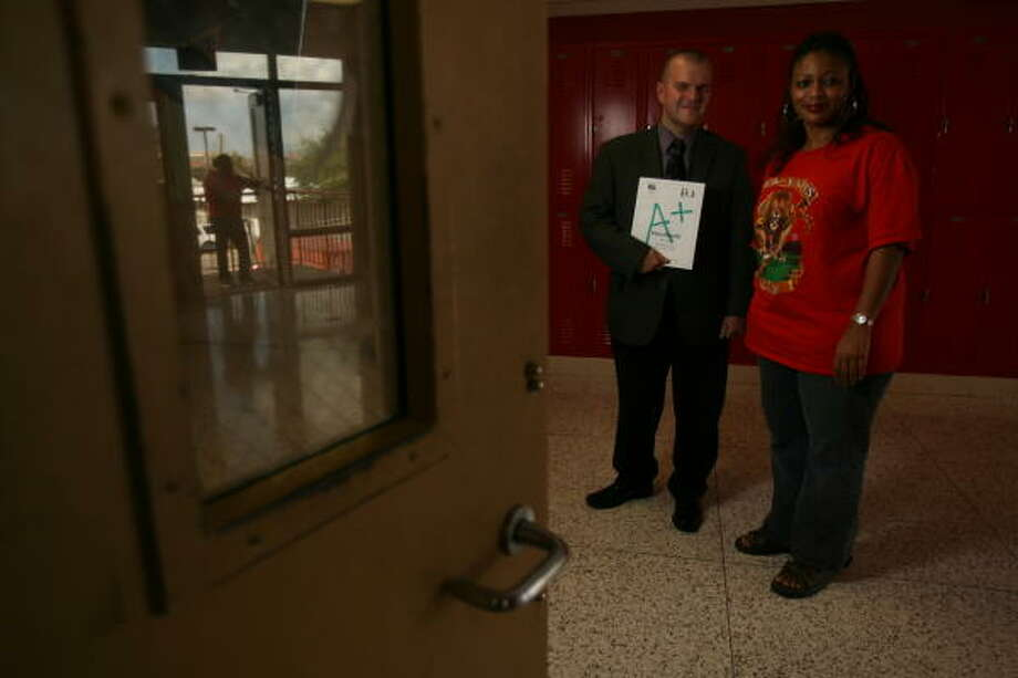 Michael Fain, director of UIL, and Terri Williams, Yates High School UIL coordinator, hope to draw more inner city students into academic competitions. Photo: Mayra Beltran, Chronicle