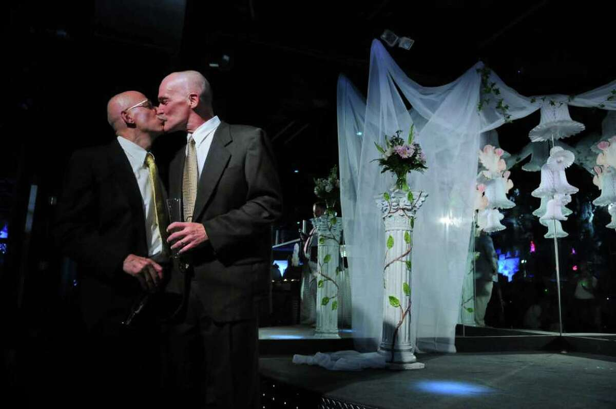 Edward Delph, left, shares a kiss with Peter Schroeter, right, shortly after their wedding ceremony at Rocks on Sunday July 24, 2011 in Albany, NY. They have been together since the late 1970's.Sunday was the first day that marriages for the state's new same sex marriage law could be performed.( Philip Kamrass / Times Union)