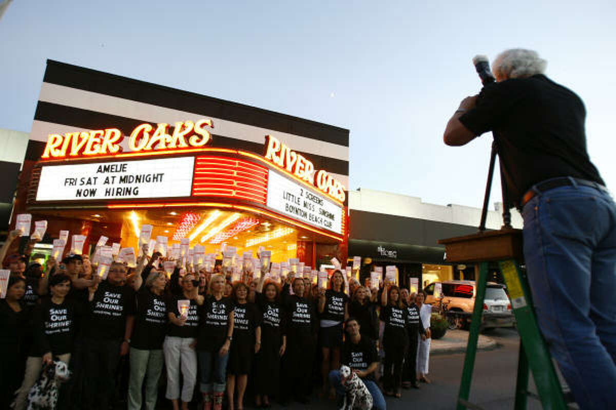 Members of the Save Our Shrines historical preservation organization gather Wednesday for a photo at the theater.