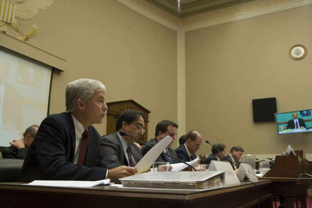 Waco attorney Billy Davis addresses members of a congressional subcommittee during a hearing on silicosis lawsuits in July. Davis is flanked by six other plaintiff attorneys subpoenaed by the subcommittee.