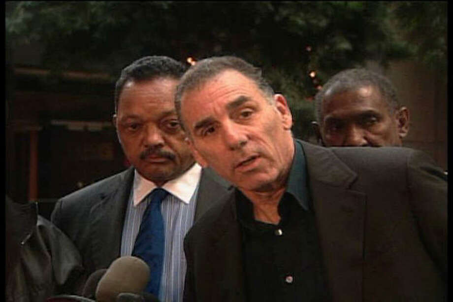 Michael Richards' appearance with the Rev. Jesse Jackson, left, was not enough to quell skepticism about Richards' claim to be Jewish. Photo: AP
