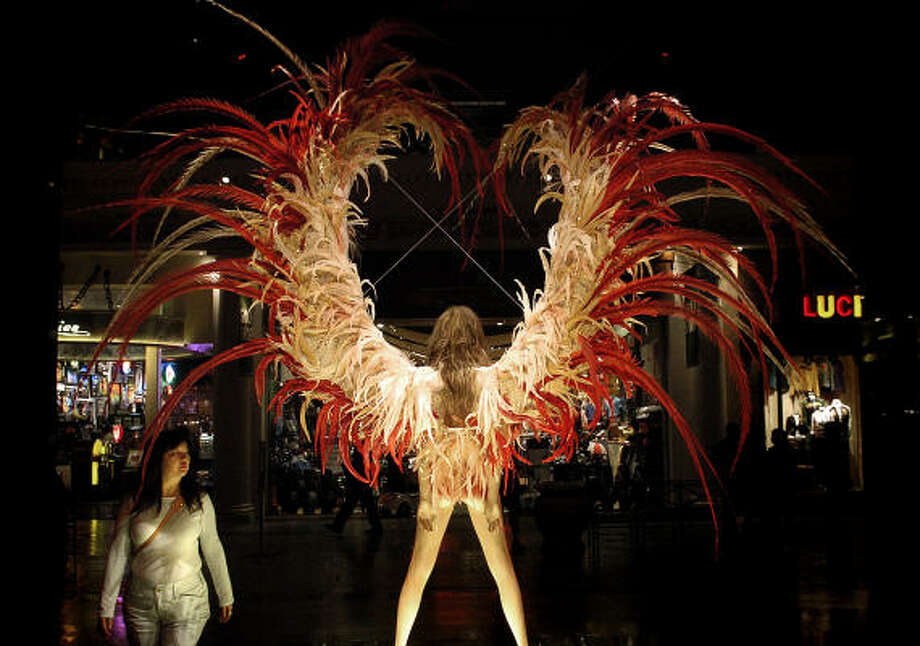Lillian Shaw checks out the display as she enters Victoria's Secret in the Forum Shops at Caesars Palace in Las Vegas. Photo: RJ SANGOSTI, Denver Post