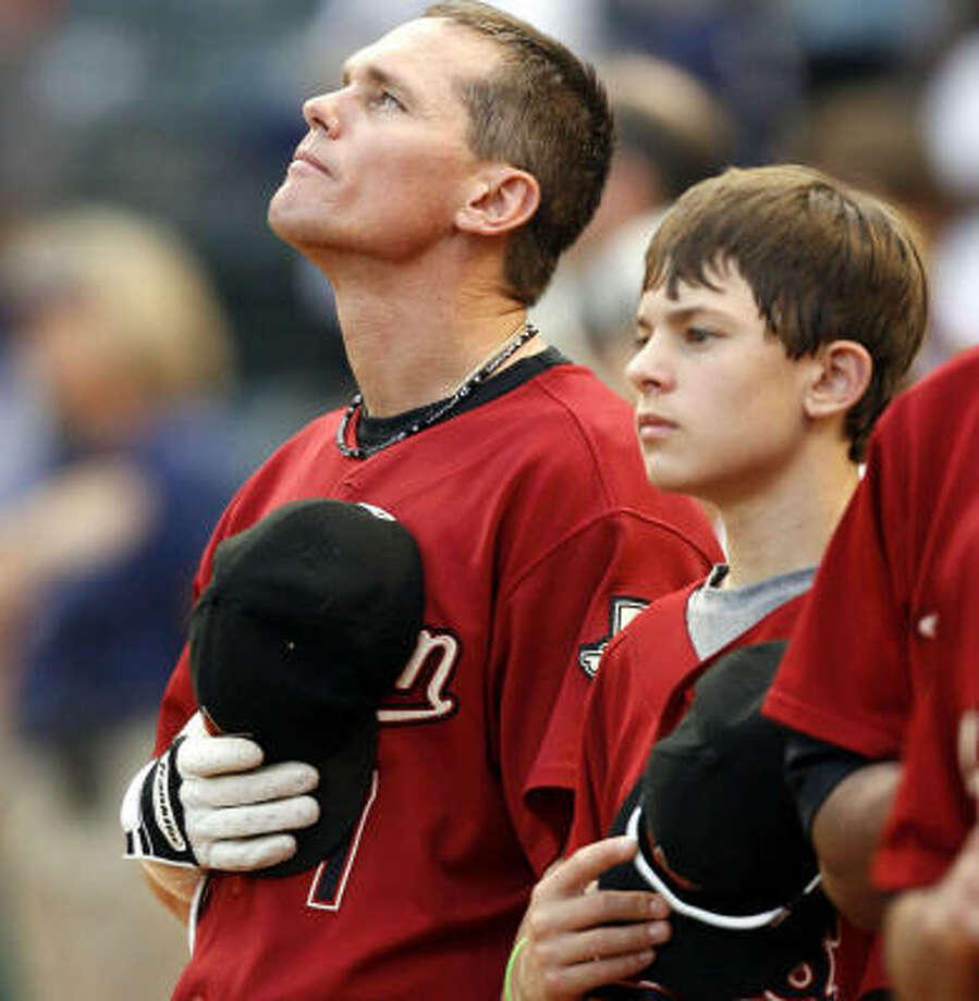Craig Biggio and his son, Conor, await the first pitch. The Astros head off to Milwaukee for the start of a series today at Miller Park. Photo: Layne Murdoch, Getty Images