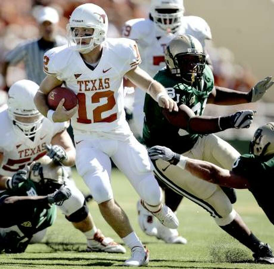 Colt McCoy gives Baylor a taste of the shifty moves he has developed. Photo: KHAMPHA BOUAPHANH, MCCLATCHY-TRIBUNE