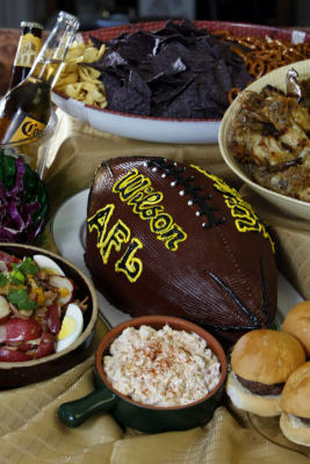 RUSHING GAME: A simple Super Bowl spread can include, clockwise from upper right, Chipotle Wings, Buttery Sliders, Chipotle Corn Dip and Hot Potato Salad. The cake, $50, is from Acadian Bakers; phone 713-520-1484. Photo: Johnny Hanson, Chronicle