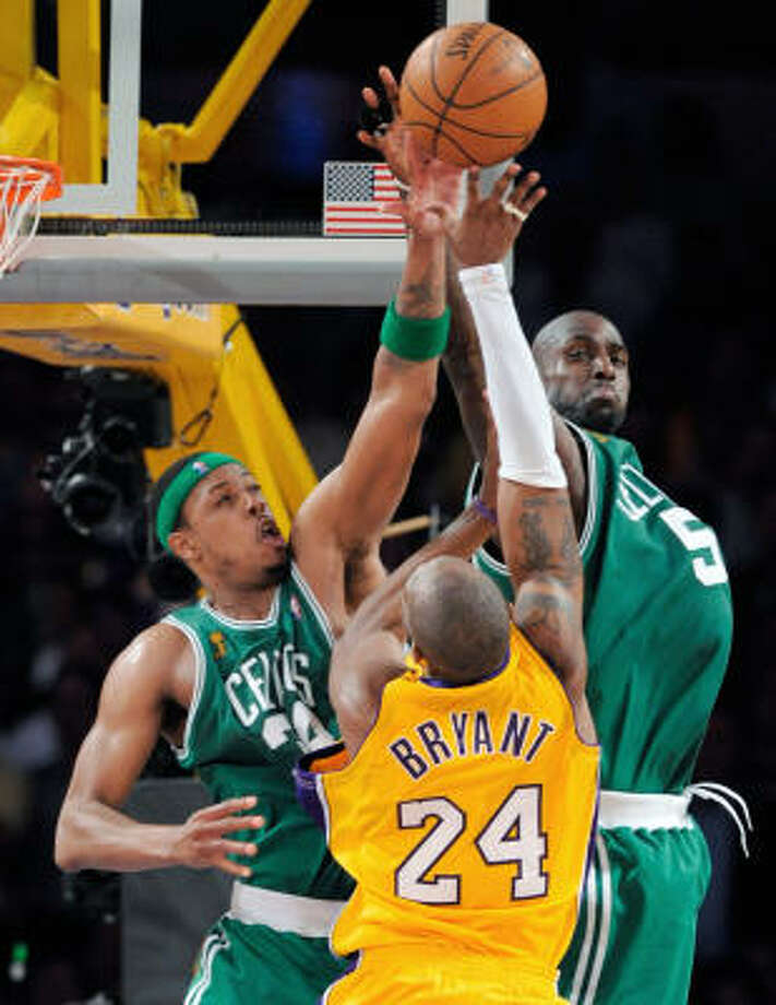 Los Angeles Lakers guard Kobe Bryant has his shot blocked by Boston Celtics forward Paul Pierce (34) and Kevin Garnett in the second half of Game 4 of the NBA Finals on Thursday in Los Angeles. The Celtics beat the Lakers 97-91. Photo: Mark J. Terrill, AP