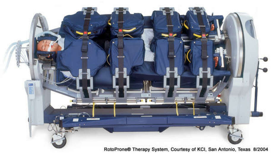 This bed rotates and can rock a patient face down to help lungs heal. It's manufactured in San Antonio. Photo: KCI