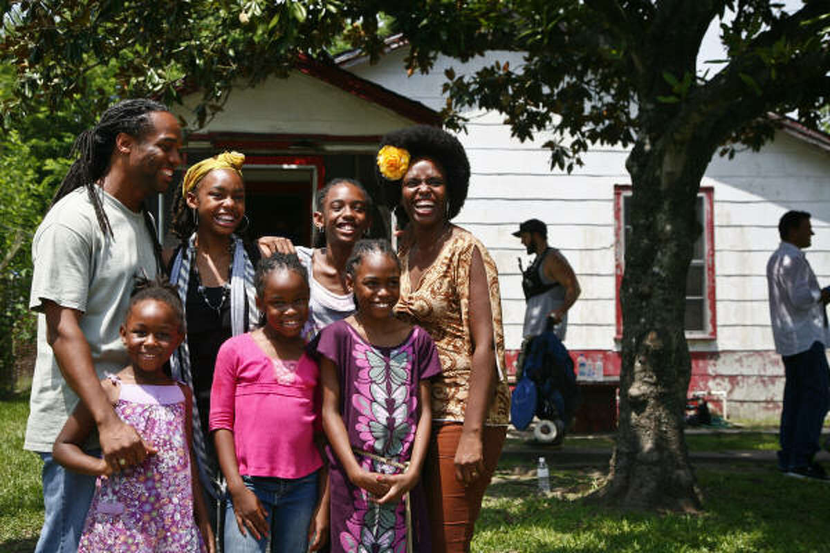 Eric and Elaine Johnson and their five girls, from left, Reagan, 5, Angela, 14, Evan, 7, Zoe, 11, and Jessica, 9, have been chosen to appear on the TV show Extreme Makeover: Home Edition. A new home will replace their dilapidated one on Goodhope.