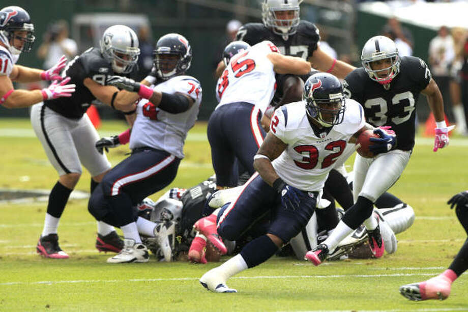 Texans running back Derrick Ward (32) cuts back against the Raiders on his way to a 33-yard touchdown run during the first quarter. Ward helped pick up the slack in the first half with starter Arian Foster forced to watch from the bench after missing a team meeting. Photo: Brett Coomer, Chronicle