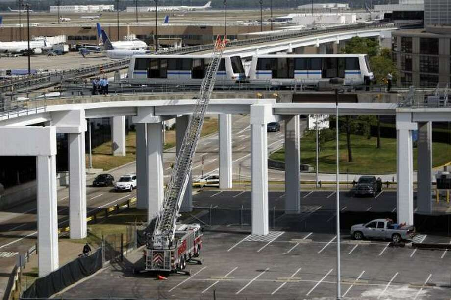 Two workers were hit in a collision along the tracks of an elevated tram at Bush Intercontinental Airport  Tuesday, Oct. 26, 2010, in Houston. Photo: Johnny Hanson, Chronicle