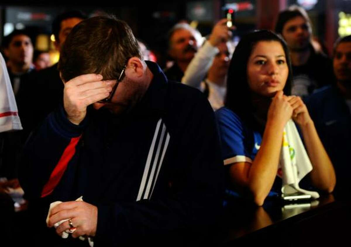 Soccer fans Craig Montgomery, left, and Yesenia Cruz are dejected Thursday in Los Angeles after learning the U.S. won't be hosting the 2022 World Cup.