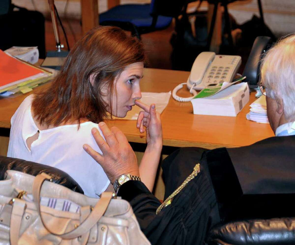 American student Amanda Knox talks with her lawyer Luciano Ghirga during the hearing Monday. (AP Photo/Stefano Medici)