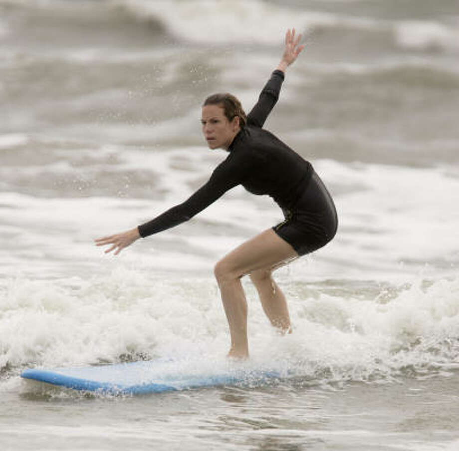 Although the tide was rough, Chronicle reporter Kristin Finan mounted her board after her lesson, and rode a wave on her first try. Photo: Thomas B. Shea, For The Chronicle