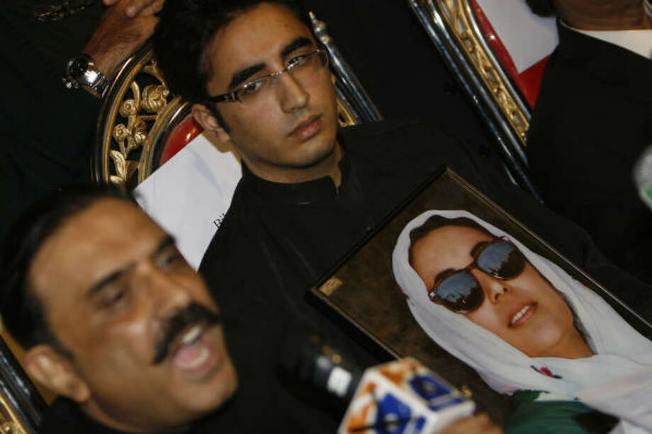 Asif Ali Zardari, left, husband of slain former prime minister of Pakistan Benazir Bhutto, addresses a news conference with his son Bilawal Zardari, top, as Bilawal was nominated chairman of Bhutto's People's party in Naudero near Larkana, Pakistan on Sunday. Photo: Shakil Adil, AP
