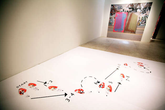 "A dance diagram by Joshua Bienko is pictured at the ""By Permit Only"" exhibit at the Guadalupe Gallery on July 15, 2011.  ANDREW BUCKLEY / abuckley@express-news.net Photo: ANDREW BUCKLEY, SAN ANTONIO EXPRESS-NEWS / abuckley@express-news.net"