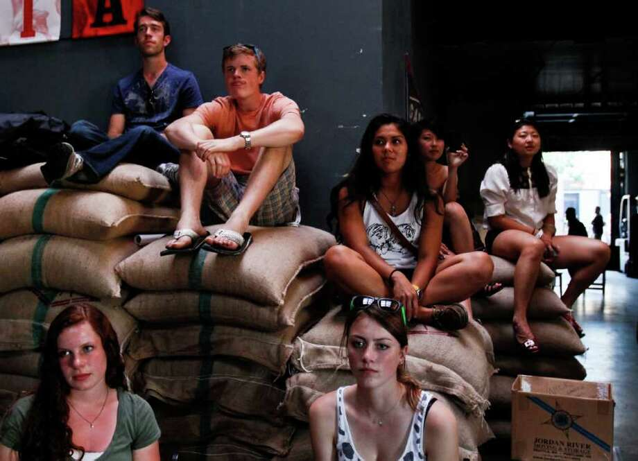 "Spectators watching the group ""Kung Foo Grip"" at the Cha Cha Lounge during the Capitol Hill Block Party in Seattle on Sunday Photo: JOE DYER / SEATTLEPI.COM"