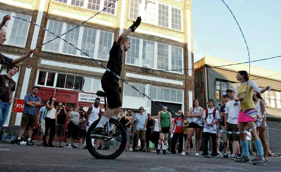 A man on a unicycle does Double Dutch jump roping at the Capitol Hill Block Party in Seattle on Sunday Photo: JOE DYER / SEATTLEPI.COM