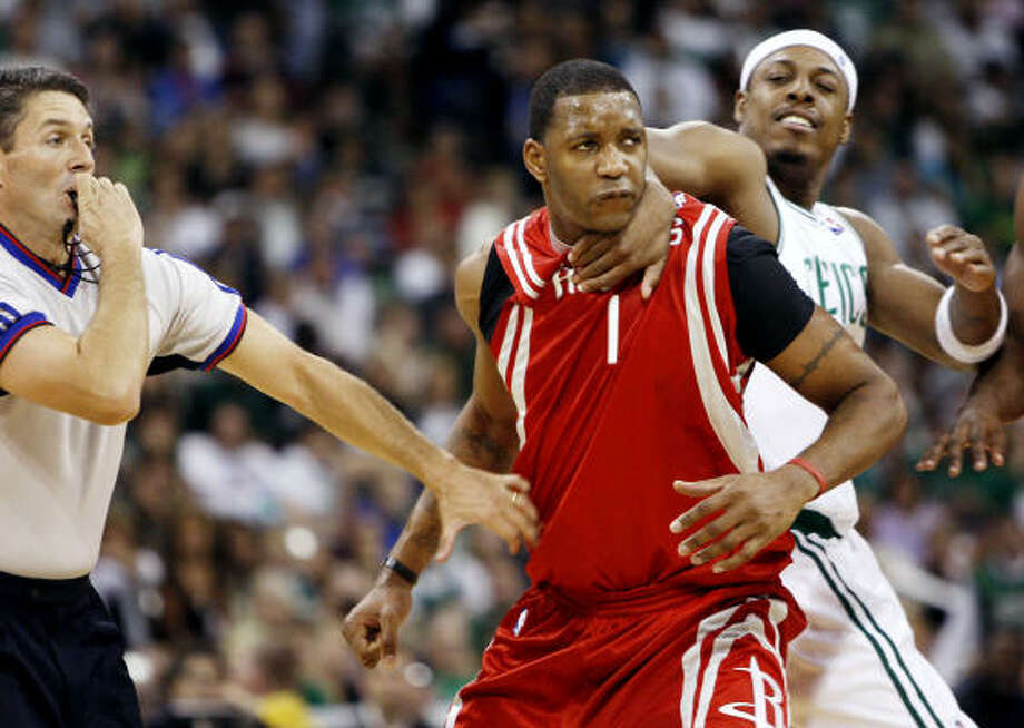 Tracy McGrady, in his first preseason action, is held by Boston's Paul Pierce after being called for a flagrant foul. Photo: Winslow Townson, AP