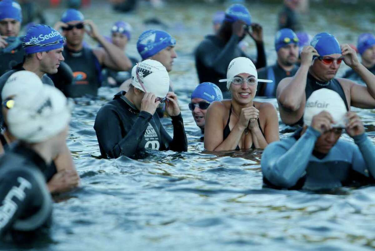 Participants prepare for the start of the Benaroya Research Institute Seafair Triathlon at Seward Park in Seattle on Sunday, July 24, 2011