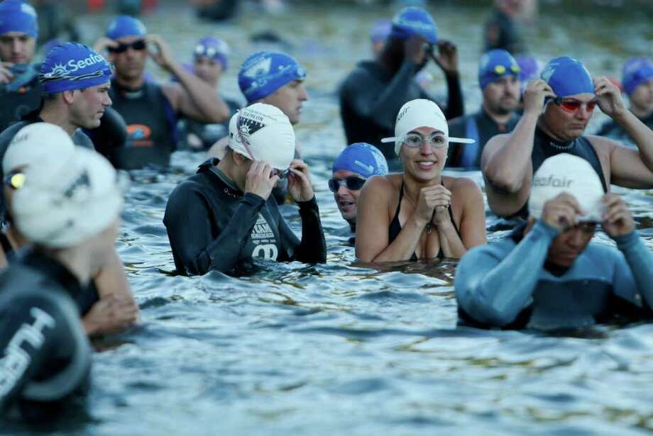 Participants prepare for the start of the Benaroya Research Institute Seafair Triathlon at Seward Park in Seattle on Sunday, July 24, 2011 Photo: JOE DYER / SEATTLEPI.COM
