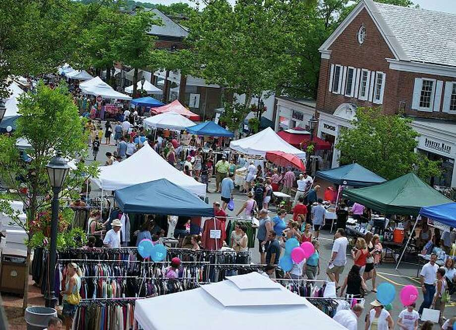 The annual New Canaan Sidewalk Sale took place this past weekend. Thousands flocked to the streets for good deals and fun. Photo by Henry Eschricht. Photo: Contributed Photo
