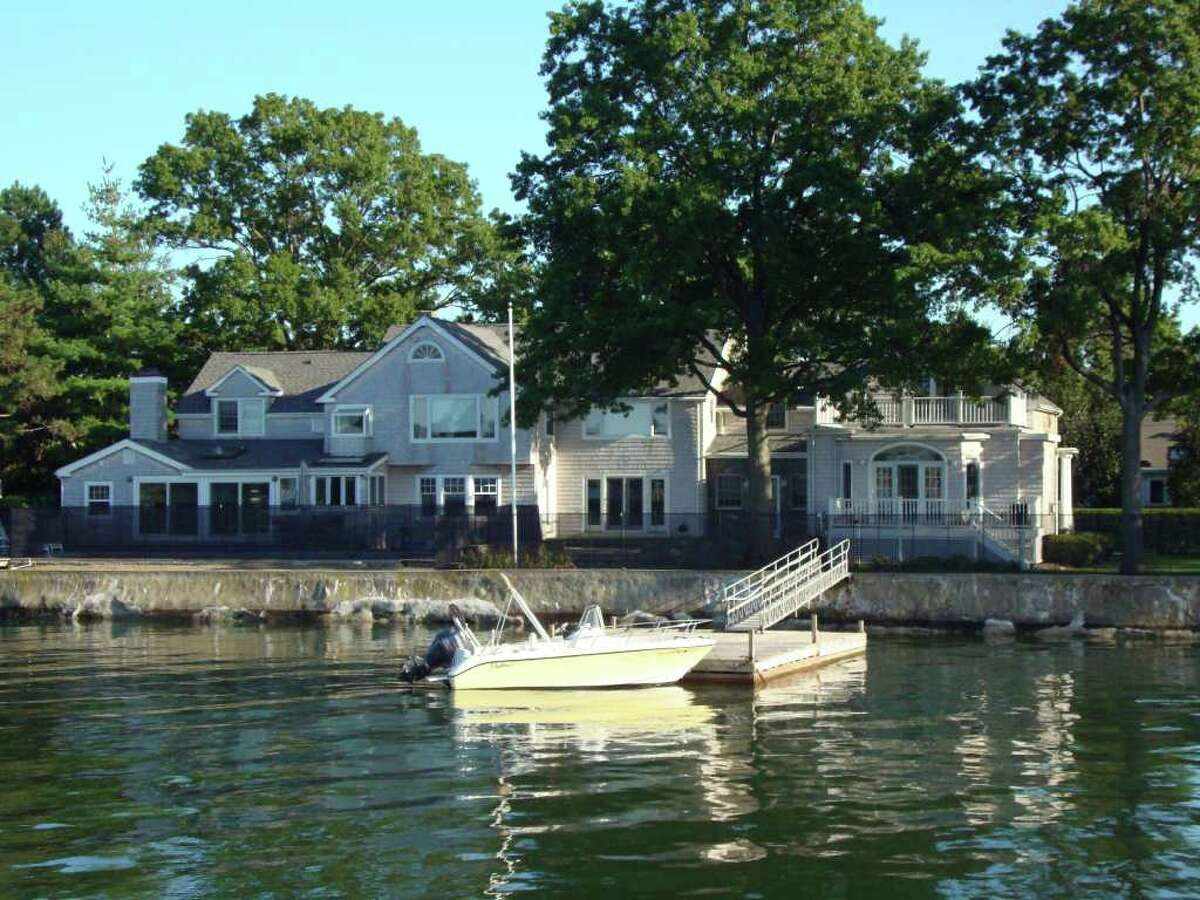 This 1939 waterfront Lucas Point house in Old Greenwich is for sale, or for rent, through the owner. With pool, spa, and private boat dock, the immaculate house on a full half-acre was, at one time, a family home of Edwin J. Lucas, creator and developer of Lucas Point.