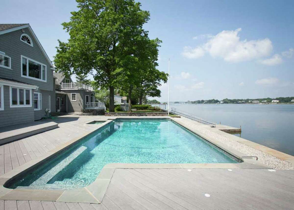 Set on a full half-acre in an R-12, 12,000 square-foot zone, the grounds hold the 5,000 square foot home and a swimming pool and spa, along with a sea wall and a private boat dock.
