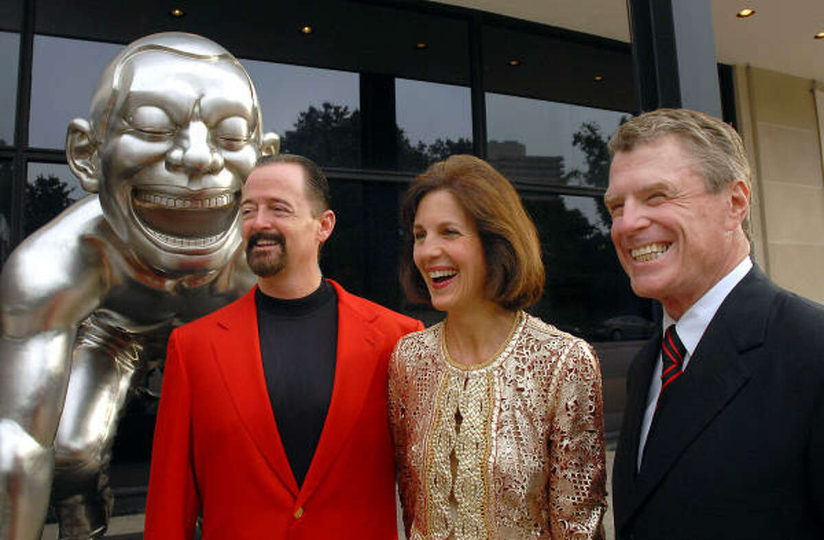 Art collectors Robert and Jereann Chaney join Museum of Fine Arts, Houston, director Peter Marzio, right, at the opening of the Red Hot-Asian Art Today exhibit.