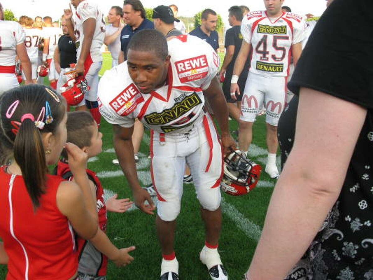 After a victory in which he rushed for three touchdowns, Sean Cooper of the German Football League's Marburg Mercenaries meets with young fans.
