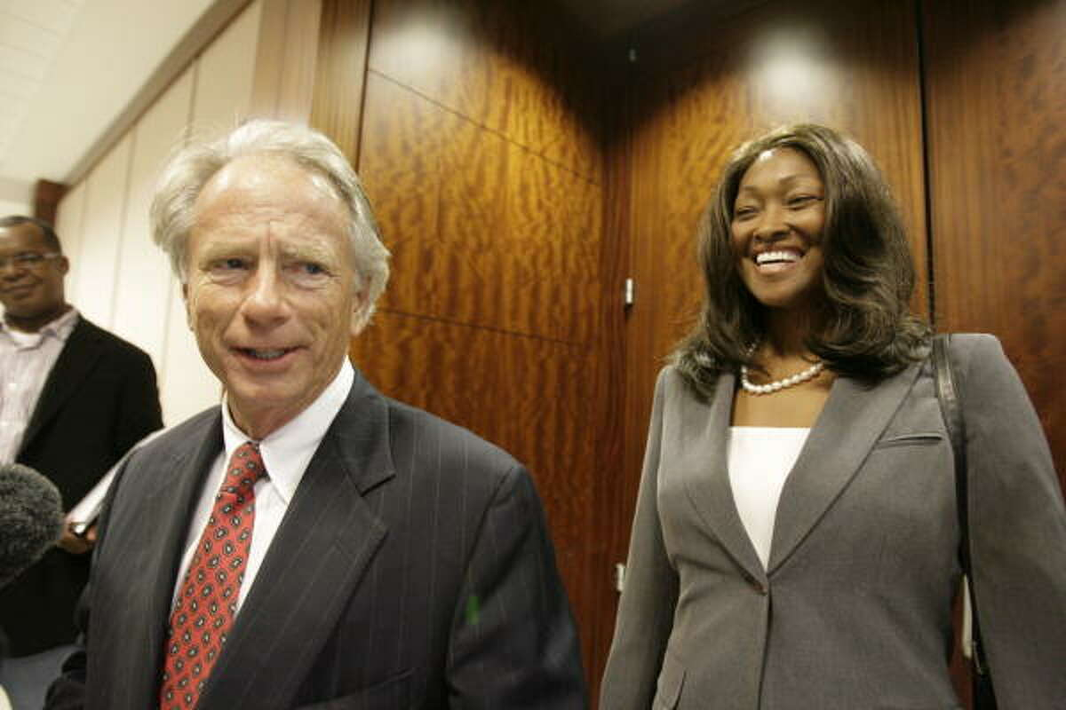 Attorney Mike DeGeurin and his client, former TSU President Priscilla Slade, smile after they struck an agreement with Harris County prosecutors Wednesday afternoon. Slade agreed to repay $127,672.18 in a plea deal that lets her avoid prison.