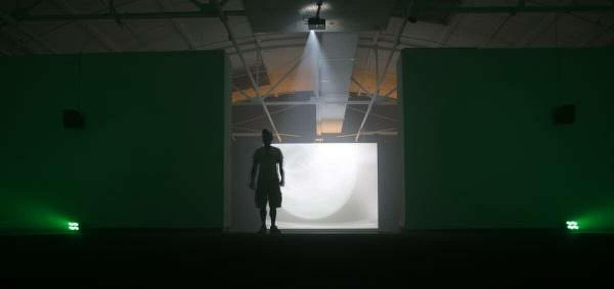 Calvin Mills of Houston walks through Stephen Vitiello's light-and-sound installation at DiverseWorks.