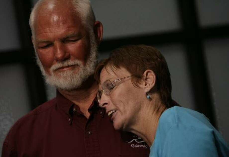 Survivor Steven Conway and his wife, Mary Conway, embrace Monday after he discussed the rescue. Photo: JULIO CORTEZ, CHRONICLE