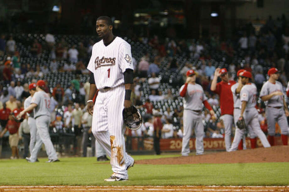 Reggie Abercrombie walks off the field as after getting doubled off second base on a line drive by Ty Wigginton to short for the final outs. Photo: Bob Levey, AP