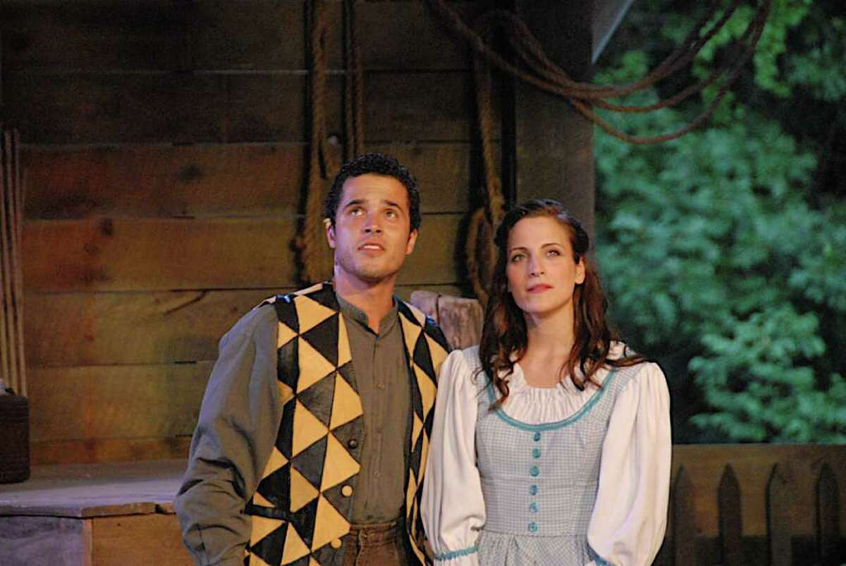 Christian Cardozo of Bridgeport, who plays Billy Bigelow, and Jazmin Gorsline, who plays Julie Jordan, perform a scene from the musical 'Carousel,' which is running through Saturday, Aug. 6, at the Summer Theatre of New Canaan at Waveny Park.